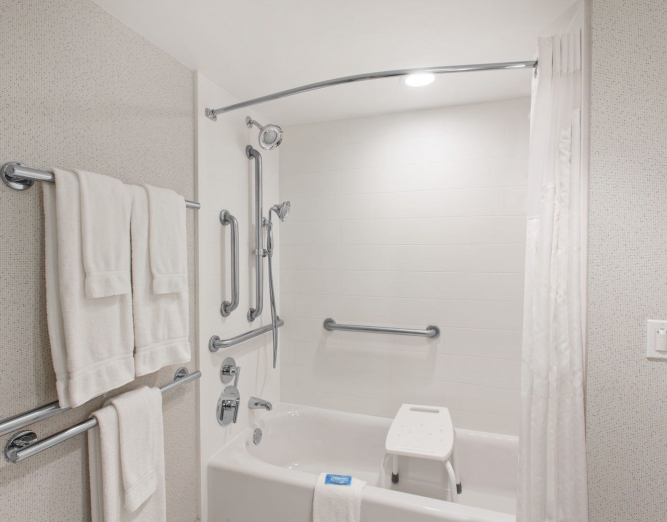 White full bathroom with ADA amenities