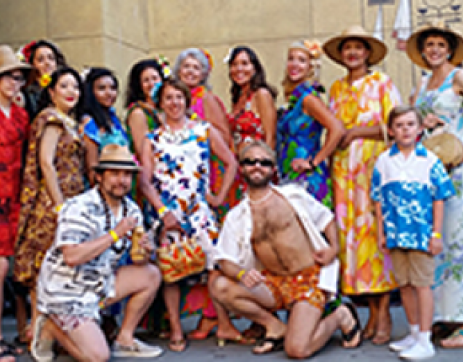 Group picture of people wearing hawaiian themed clothing