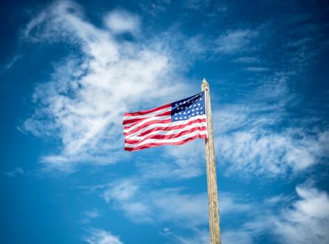 American Flag Against Blue Sky