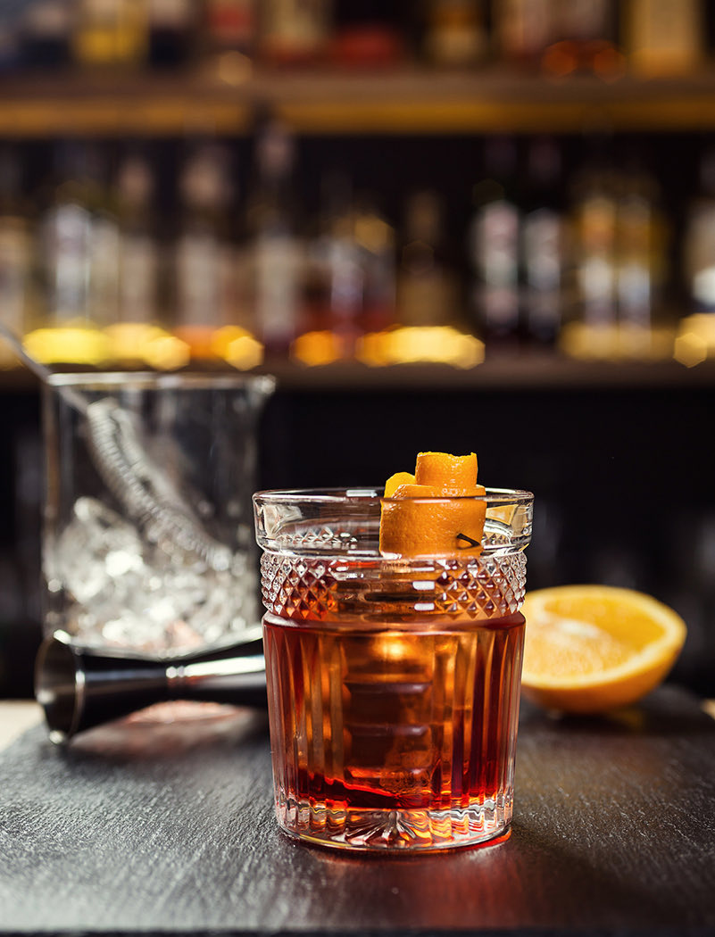cup of old fashion on bar