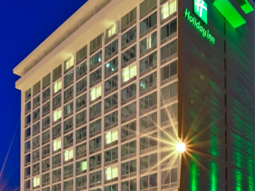 Holiday Inn Tulsa Exterior of building at night