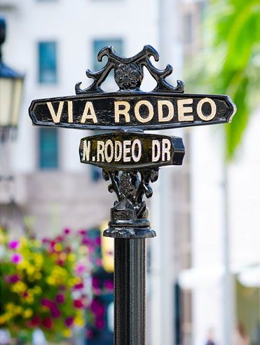 Via Rodeo metal street crossing sign