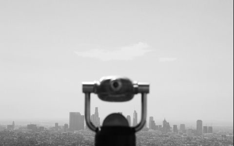 Binocular with city skyline in the back