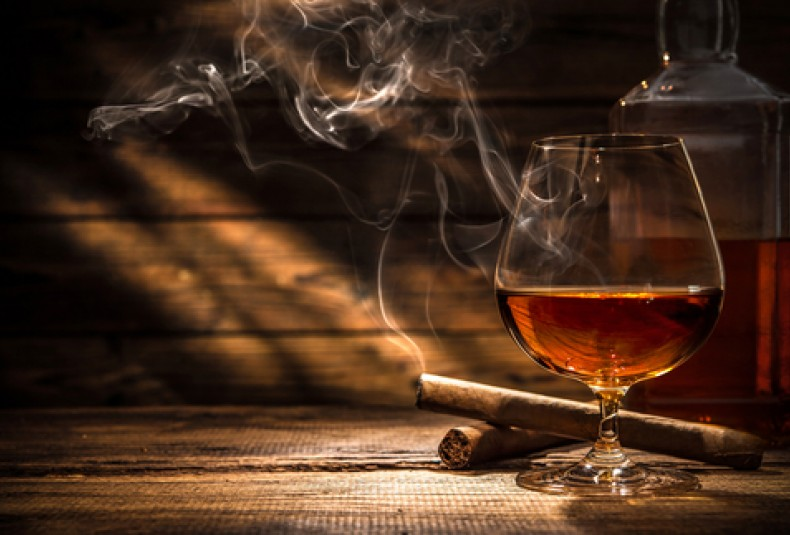 cigar and whiskey in a suana