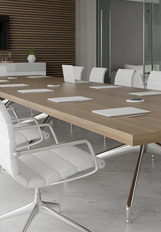 conference table in a room with white rolling chairs