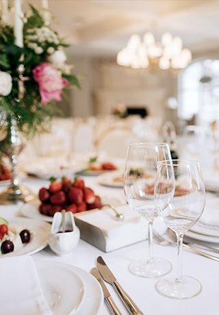 close up of a table at a wedding reception with plates of strawberries