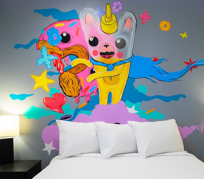 Mural painting behind bed