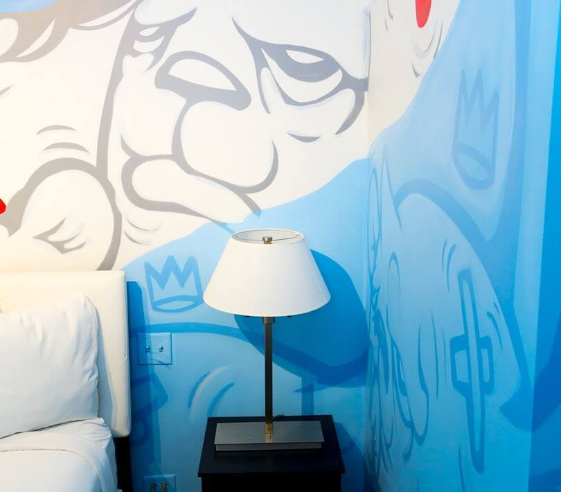 Cartoon mural behind bed