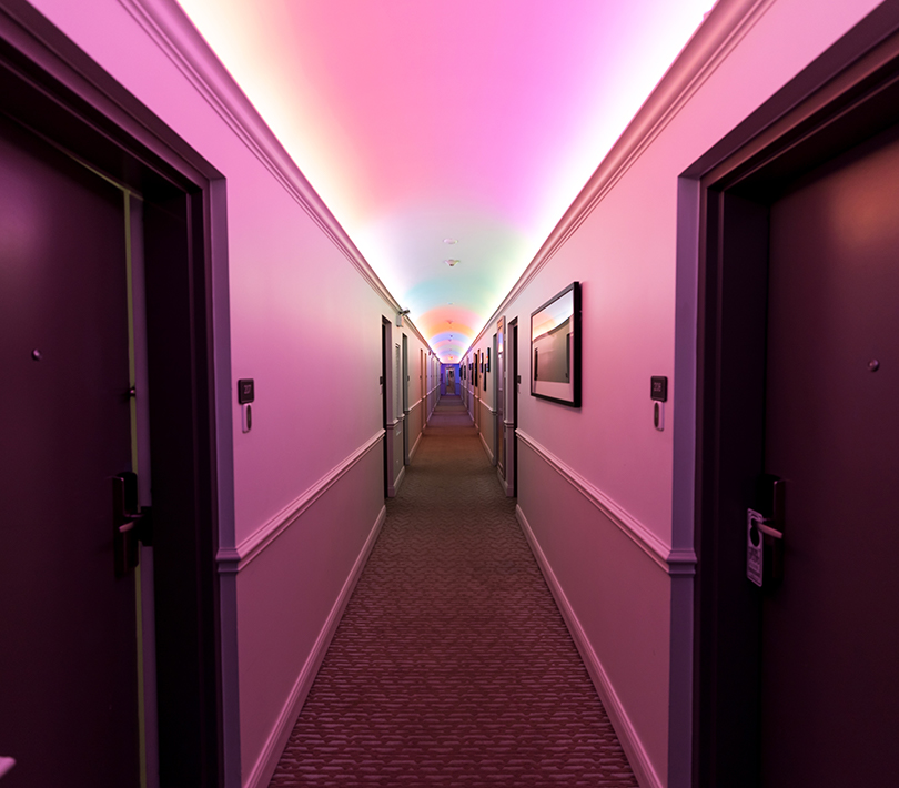 hallway lit with pink lighting
