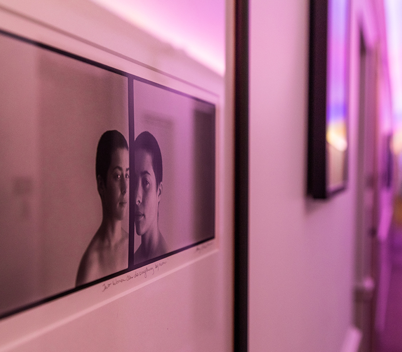closeup of a photograph on a wall with pink lighting