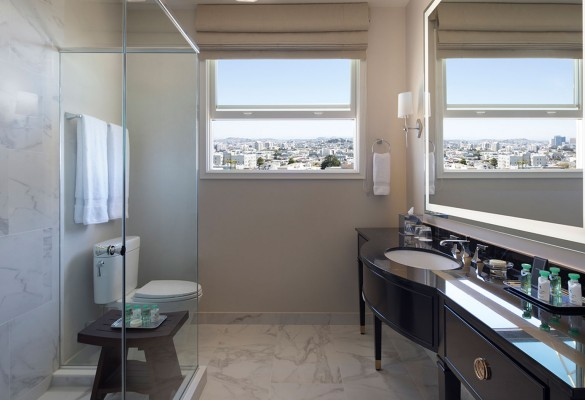 bathroom with black vanity and view of the city