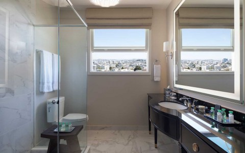 Bathroom with walk in shower, vanity, and view