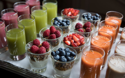yogurt parfaits and orange, green and purple juices