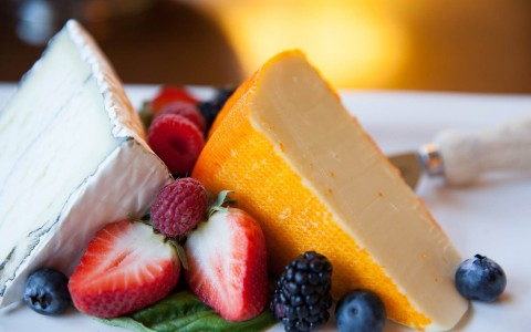 Cheese and fruit on plate