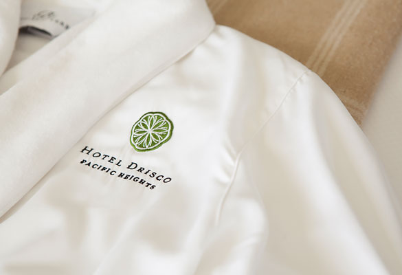white robe with hotel logo