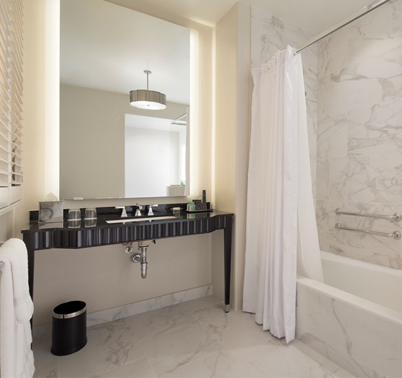 marble bathroom with a step in bath tub shower