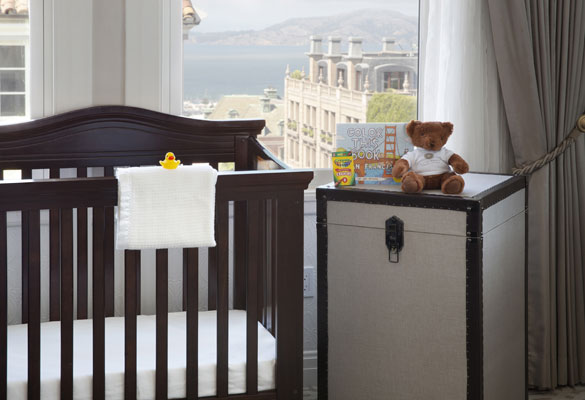 crib and hamper overlooking city