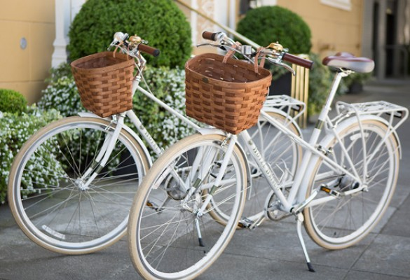 set of chic white bicycles with wicker basket