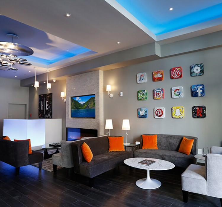 Living space with couches, tables & social media wall art