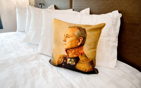A pillow with Bill Murray dressed as a general in front of four plain white pillows