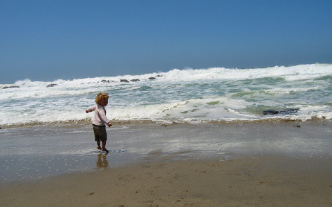 Small Child Running on McClures Beach at Point Reyes California