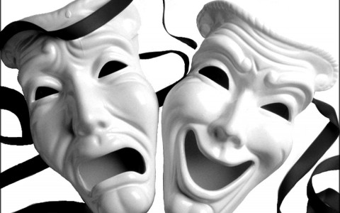 White Theater Masks Depicting Comedy and Tragedy