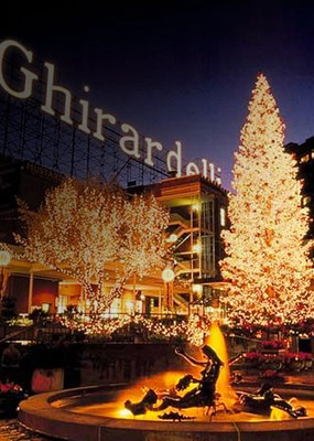 Lit up Christmas tree at night in front of Ghirardelli factory