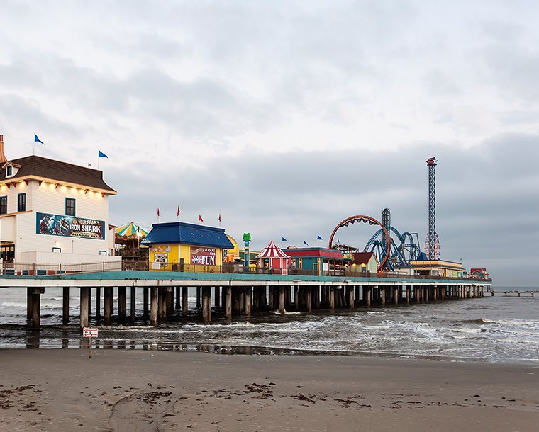 View of the Galveston Pier from the beach