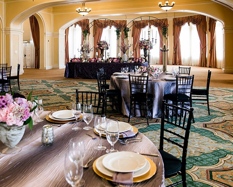 table setup with purple cloth and chairs in ballroom