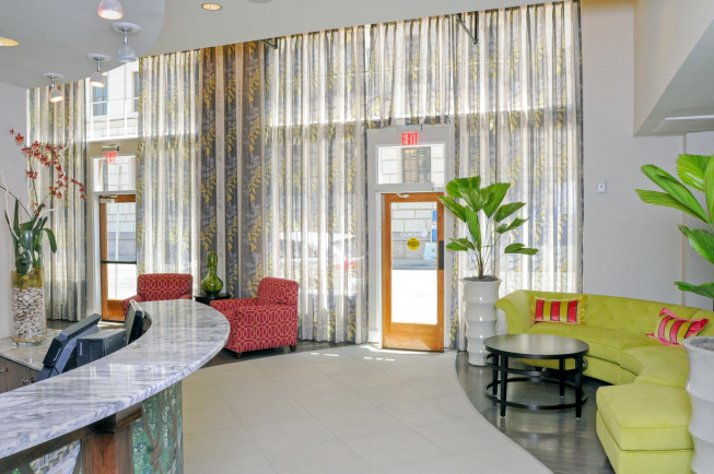 hotel gibbs lobby with green sofa and glass windows