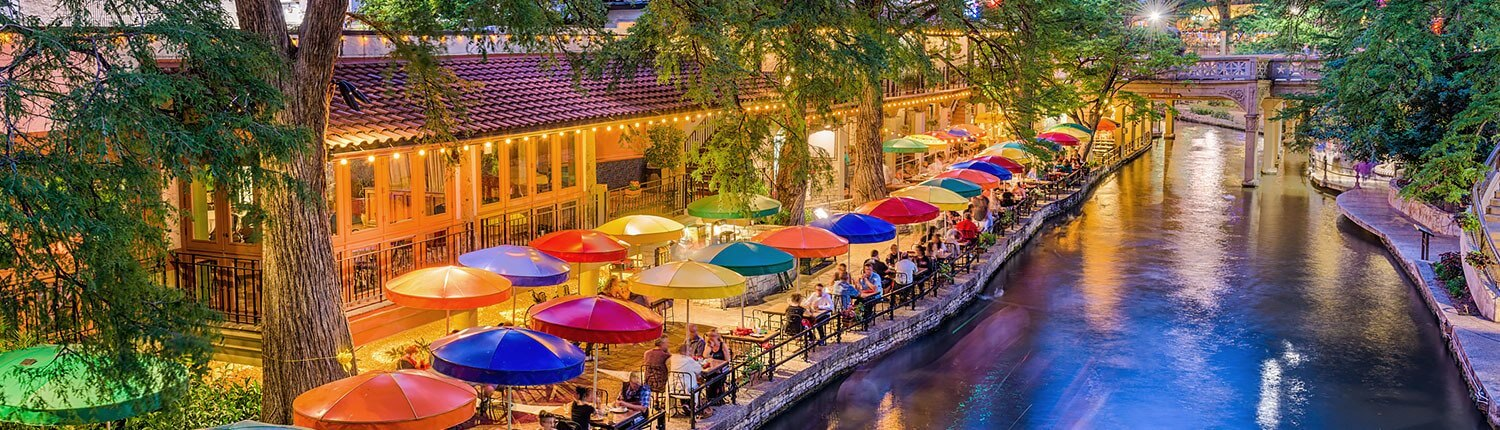 overview shots of riverwalk with colorful umbrellas