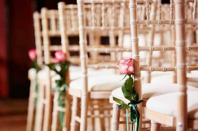 Wedding chair lined up with flowers