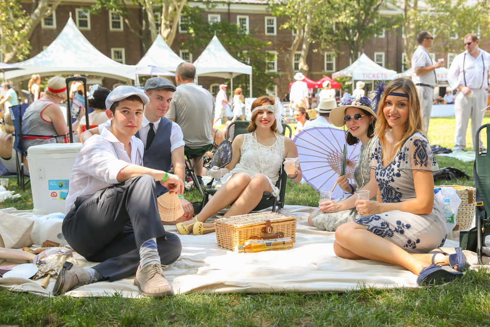 Group of young people picnicking in Jazz Age attire