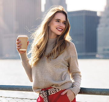 woman enjoying a coffee in the city