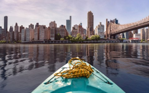 new york city skyline seen from a kayak