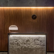 front desk in front of wood wall