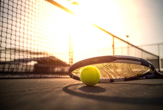 Tennis ball and racket on a court