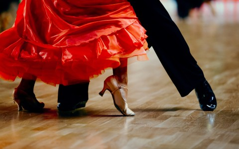 two people's feet dancing tango