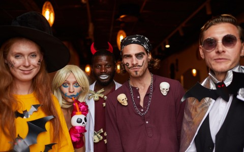 group dressed up in halloween costumes