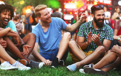 friends at a concert on a lawn