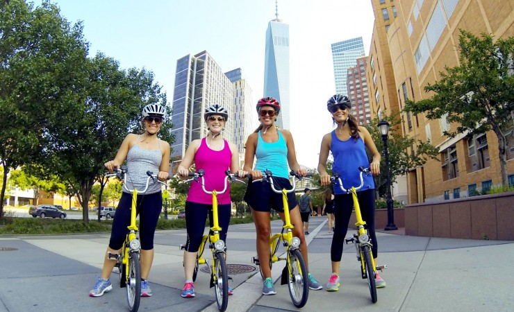 women on bikes in the city