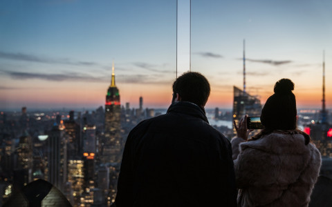 couple looking at sparkling manhattan from the top of the rock