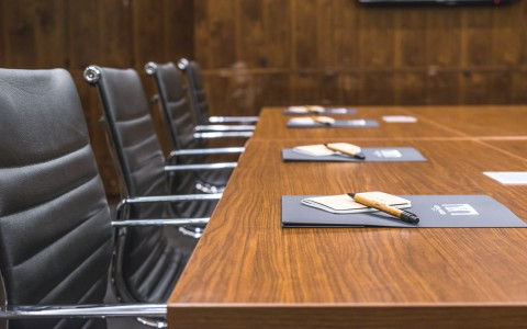 chairs around a conference table before a meeting