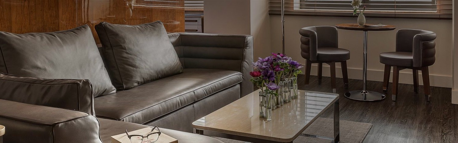 a seating area with fresh flowers on the table