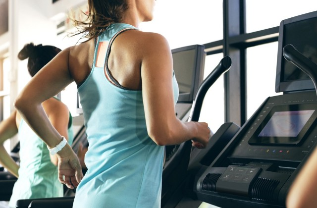 woman on elliptical machine