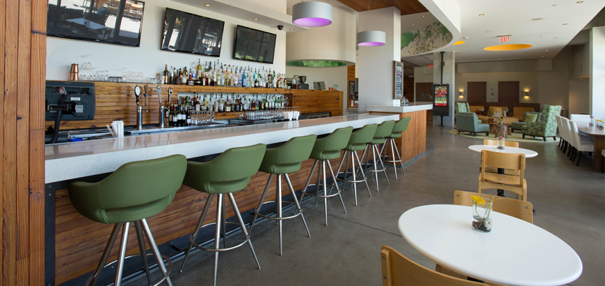 Madison bar and bistro features a bar top and small tables and chairs retro themed decor  5a68fc3176c23 870x412 1