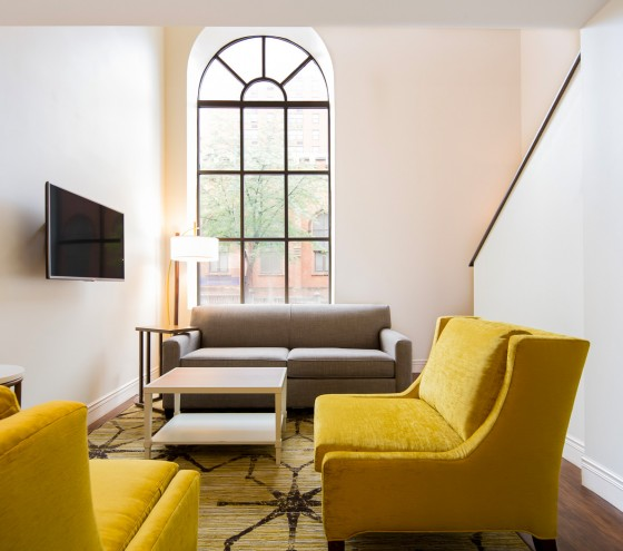 In room living area with yellow couches