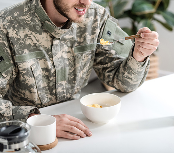 Man in uniform enjoying food