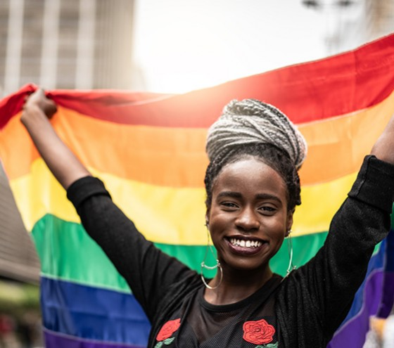 Woman holding rainbow flag