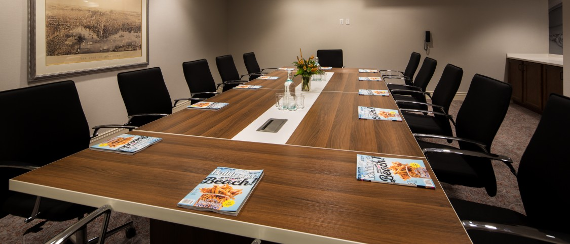 meeting boardroom contains large rectangular table to see over 10